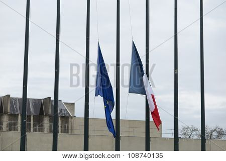 Half-mast French Flag And European Flag