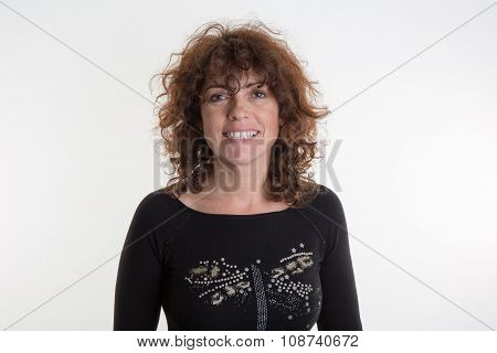 Stylish Caucasian Woman In Casual Attire Smiling At The Camera,  Curly Hair.