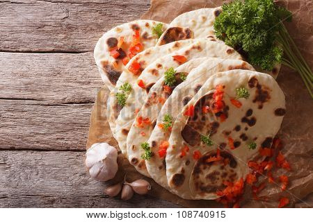 Indian Naan Flat Bread With Garlic And Herbs. Horizontal Top View