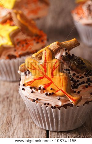 Beautiful Cupcakes Decorated With Autumn Leaves Macro. Vertical