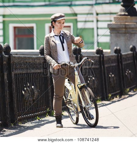 Young Woman At Vintage Bicycle British Style