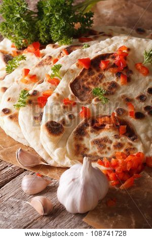 Indian Naan Flat Bread With Garlic And Pepper Macro. Vertical