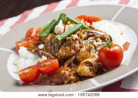 Szechuan Chicken With White Rice On A Plate