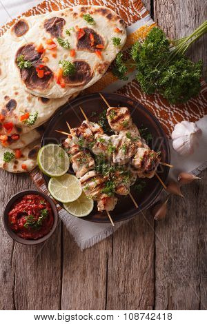 Chicken Tikka On Skewers, Flat Bread And Chutney. Vertical Top View