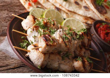 Delicious Chicken Tikka Kebabs On Skewers Close-up. Horizontal