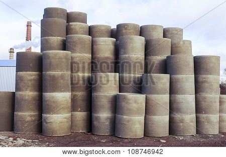 stacks of concrete rings for sewer