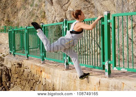 The image of climbing over a fence girl athlete
