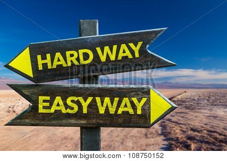 Hard Way Easy Way signpost in a desert background
