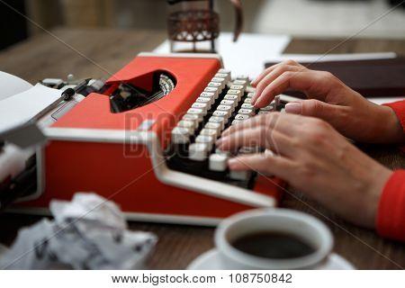 Side view of typewriter on desk