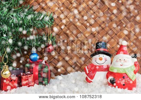 Santa Claus And Snowman With The Snow In Wicker Background