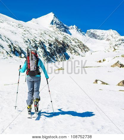 Ski touring in sunny weather.