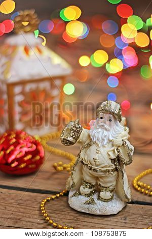 New Year's Still Life With Santa's Figure And A Garland On A Background.