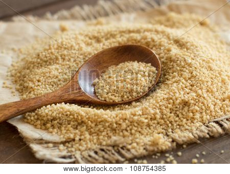 Pile Of Whole Wheat Couscous With A Spoon