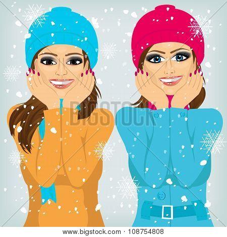 two attractive brunette women friends outdoors