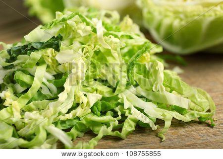 Cut savoy cabbage on cutting board closeup