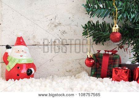 Santa Claus On The Snow With Christmas Tree In Vintage Background