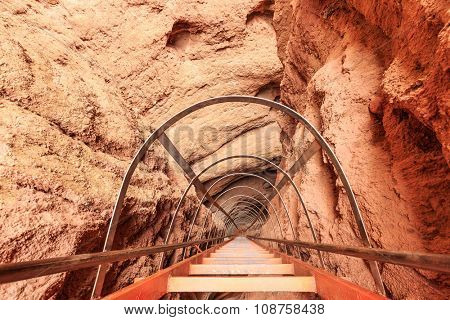 interior of cave with ladder of red sandstone
