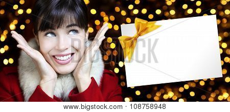 Christmas Woman With Card In Golden Lights Background