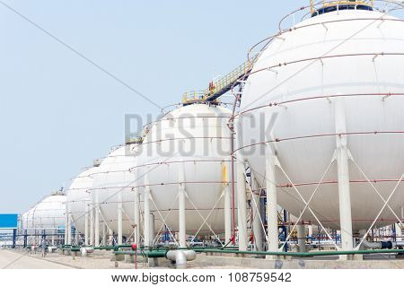 white tanks in oil depot in clear sky