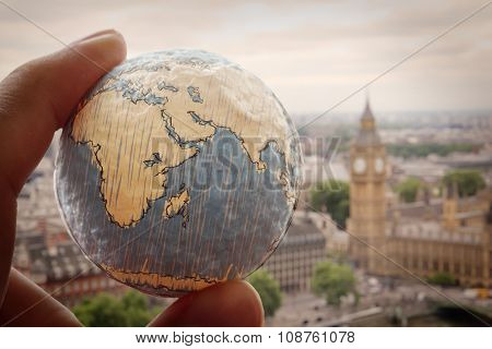 Close Up Of Businessman Hand Showing Texture The World With London City Background Elements Of This