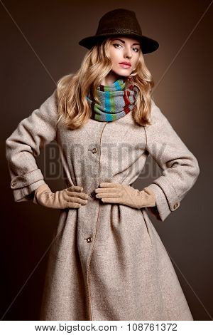 Fashion beauty woman in stylish coat and hat