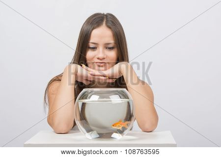 Beautiful Girl Looks At The Aquarium Presented With Goldfish