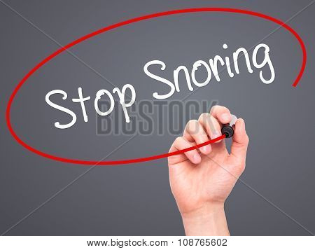Man Hand writing Stop Snoring with black marker on visual screen.