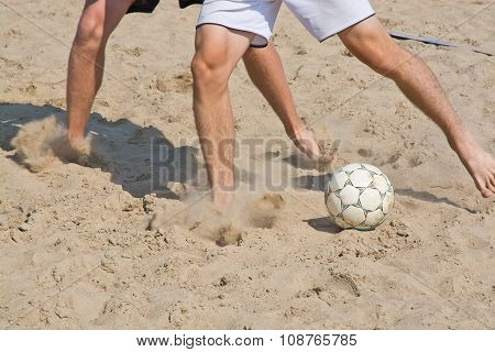 Beach soccer legs and ball