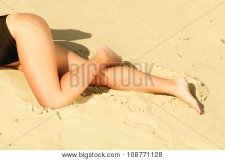 Girl Sunbathing Tanning On The Beach.