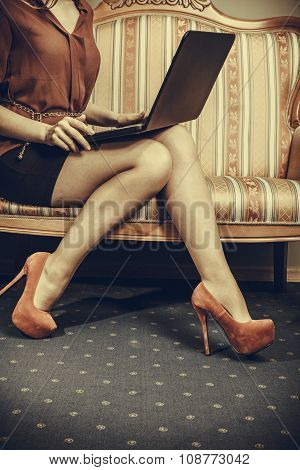Fashion Woman Sitting On Sofa Using Pc Laptop