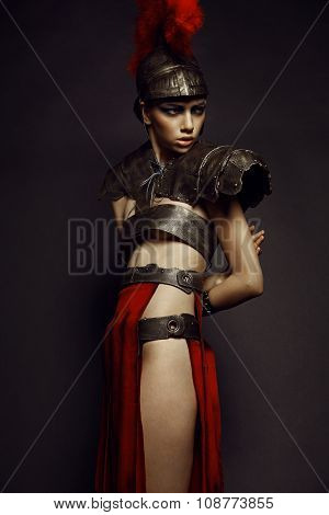 Beautiful Roman woman in armour and helmet