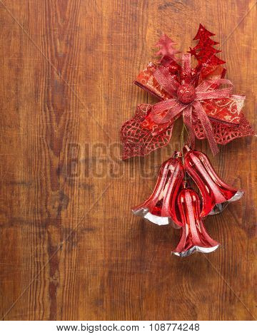 Christmas bells on wooden background.