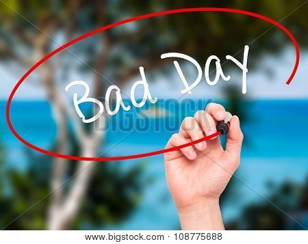 Man Hand writing Bad Day with black marker on visual screen.