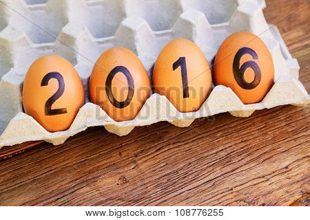 2016 word from eggs in paper tray.