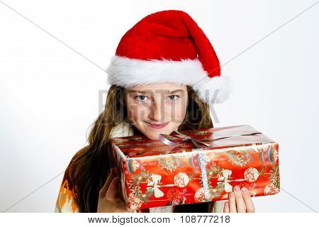 Cute Teenage Girl In Santa Red Hat With Gift Box