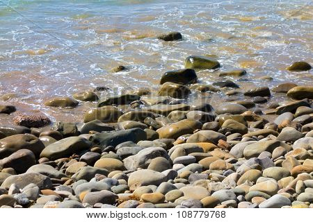 Beach With Rocks And Pebbles Background