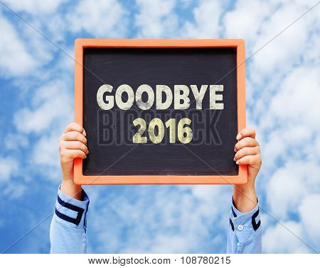 Hands Holding Blackboard With Goodbye 2016 Year.