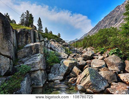 Large Pieces Of Rock In A Mountain Stream