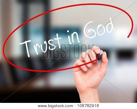 Man Hand writing Trust in God with black marker on visual screen.
