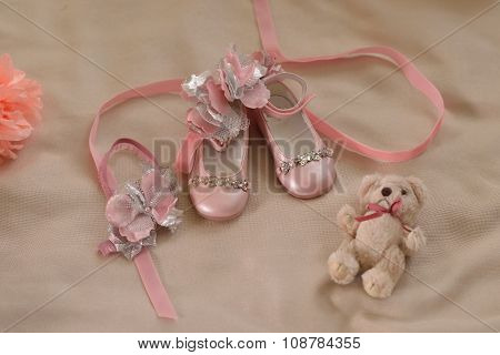 Children Shoes And Flowers