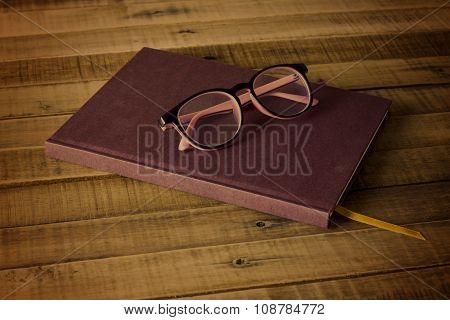 Book With Glasses  On The Wooden Background, Concept Filter Sepia .