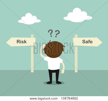 Business concept, Businessman confused about two direction, between risk or safe.