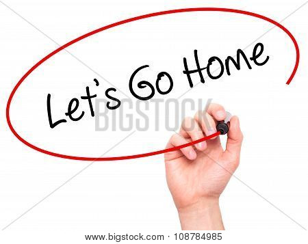 Man Hand writing Let's Go Home with black marker on visual screen.