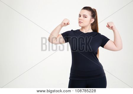 Portrait of a beautiful fat woman showing her biceps isolated on a white background