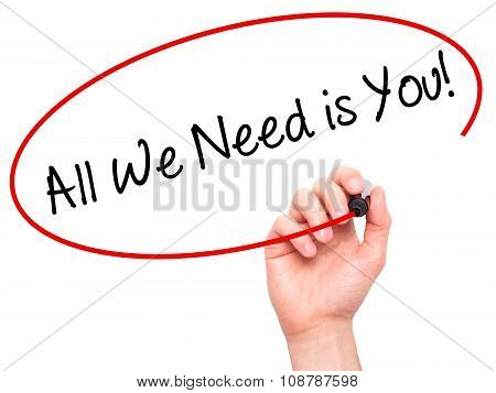 Man Hand writing All We Need is You! with black marker on visual screen.
