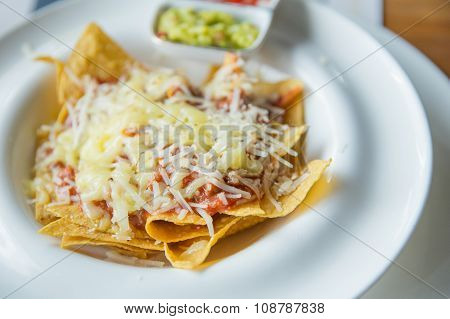 Mexican Food Nachos With Sauce And Cheese