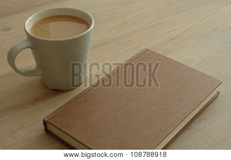 Book and coffee on a table