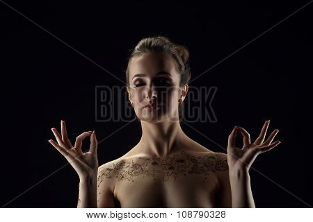 Yoga. Nude woman meditating, her hands in mudra