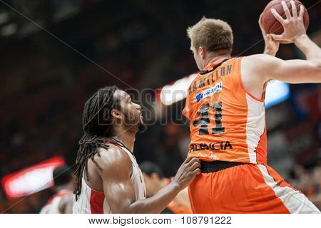 VALENCIA, SPAIN - NOVEMBER 18th: Hamilton with Ball and Falker during Eurocup between Valencia Basket Club and Sluc Nancy at Fonteta Stadium on November 18, 2015 in Valencia, Spain