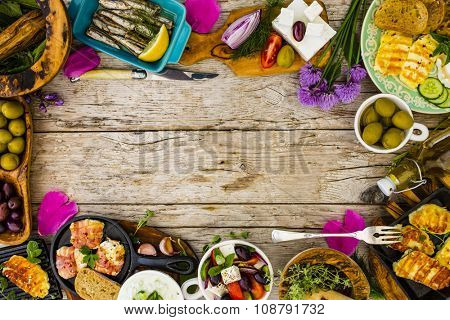 Greek cuisine dishes - frame with copy space